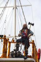 A Pirate Ship and Pirate Statue photo