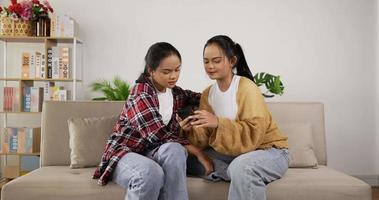 Twin Girls on The Couch and Shopping Online with Smartphone video