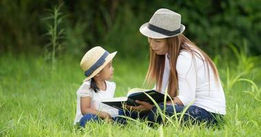 Mom and Child Reading a Book video