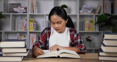 Women Carefully Reads for Exams video