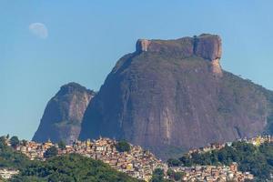 Pedra da Gavea with the moon setting in Rio de Janeiro. photo