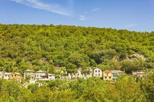 Row of houses in nature panorama in beautiful Croatia. photo