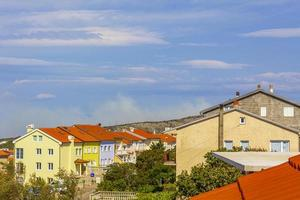 Novi Vinodolski in Croatia on a sunny day with smoke from the forest fire in the horizon photo