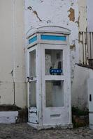 Old telephone booth that still survives in a city photo
