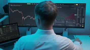 Back view on cheerful businessman checking stock market data photo