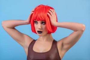 Portrait of beautiful sexy woman in short red wig photo