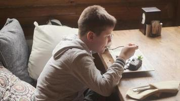 Boy eating dessert photo