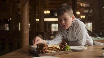 Boy eating in a restaurant photo