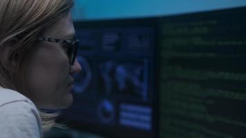 Cyber policewoman sitting in front of a computer photo
