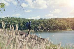 Hiker man adventure on vacation. Holiday tourism concept. photo