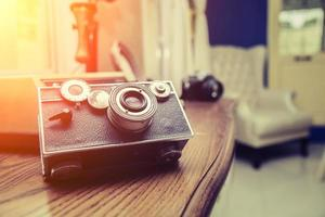 retro camera in the wood desk with sunrise photo