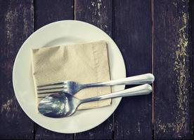Vintage of spoon and fork on white plate photo