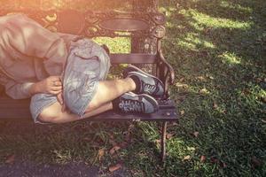 Homeless man sleep in the park photo