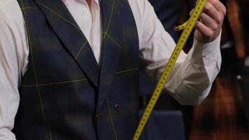Tailor with a measuring tape photo