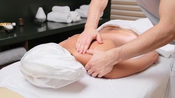 Young woman getting a massage in a spa photo