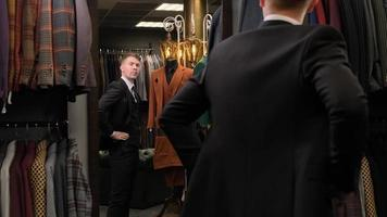 Man checking the fit of his suit photo