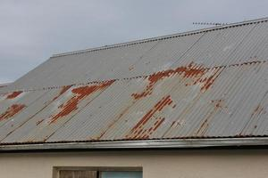 Rusting steel corrugated roof sheets photo
