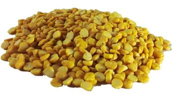 Pile of yellow peas on a white background photo