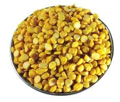 Pile of yellow peas in a bowl on a white background photo