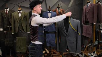Tailor measuring suits photo