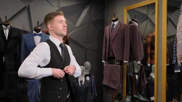 Man putting on a suit photo