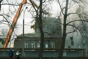 Demolition of house process with mechanical crushing claws photo