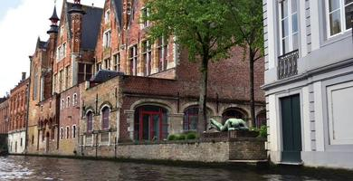Bruges, Belgium - 29th April 19, An old building on the canal waterfront in the city of Bruges photo