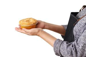 Woman hold meat pie on white background photo