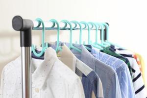 Pastel kid shirts hanging on rack photo