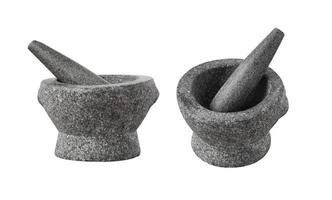 Asian stone mortar and pestle for cooking curry paste on white photo