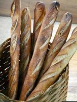 Basket of bread baked in a wood oven photo