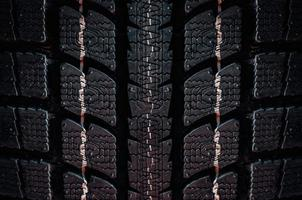 Close up on a tire on a dark background photo