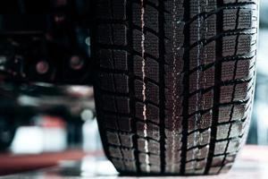 Close-up image of car wheel with black rubber tire photo