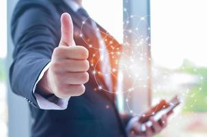 businessman showing thumbs up telecommunication connection photo