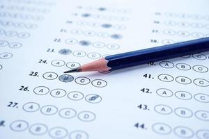 Pencil on multiple choice test paper. photo