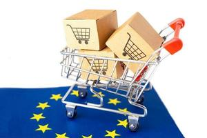 Box with shopping cart logo and Euro flag, Import Export photo