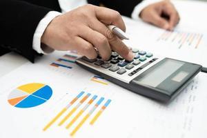 Asian accountant working financial reports photo