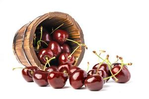 Berry Cherry in wooden round barrel pot on white background. photo
