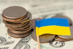 Ukraine Flag on coins background, Business and finance concept. photo