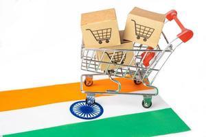 Box with shopping cart logo and India flag, photo