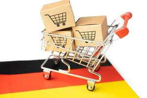 Box with shopping cart  and Germany flag, photo