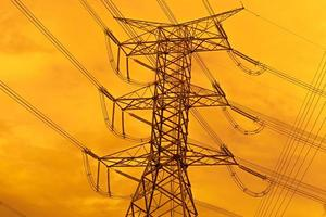 High voltage electric pole with power line electricity engineer photo