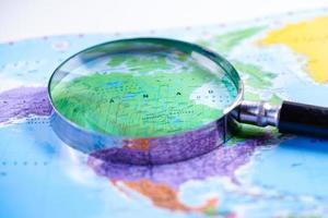 Magnifying glass on US America world globe map. photo