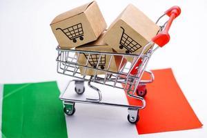 Shopping cart on Italy flag. photo
