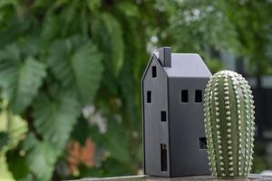 miniature house model with green nature background photo