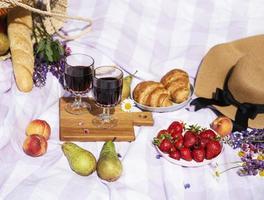 Romantic picnic scene on summer day photo