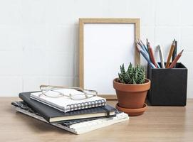 Office desk table with notebooks photo