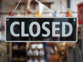Closed sign on a shop window photo
