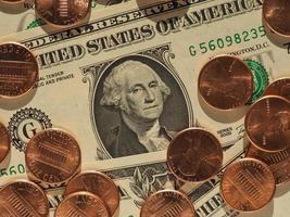 billetes de dólar y monedas, estados unidos foto