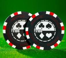 Gambling chips on the green photo